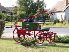 """A horse or man drawn, hand pumper. Six firemen were required to pump a steady stream of water from a single 3"""" hose. Usually from a stream. The earliest form of a fire apparatus...."""