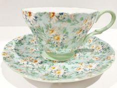 Light hearted Daisy Chintz placed upon a Henley shaped tea cup and saucer adds elegance to every setting. Shelley Fine Bone China of England designed this charming chintz teacup. The pattern is called Marguerite. It was registered in 1963. The name was later changed to Melody in June