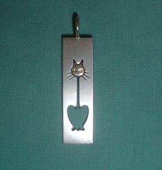 Sterling silver modernist cat pendant signed Kupittaan Kulta Finland vintage 1970s. £65.00, via Etsy.