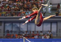 Switzerland's Ilaria Kaeslin performs on the uneven bars during the women's qualification at the Gymnastics World Championships in Nanning, in China's southern Guangxi province on October (Greg Baker/AFP/Getty Images) Gymnastics Facts, Gymnastics Images, Gymnastics World, Gymnastics Posters, Olympic Gymnastics, Rhythmic Gymnastics, Gymnastics Things, Amazing Gymnastics, Hip Hop