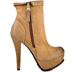 Own the town in these awesome Kelsi Dagger booties.  Shaina brings you a light luggage leather upper with a side zipper and 4 3/4 inch heel.  Pair this 1 1/2 inch platform style with leggings, dresses or denim to keep you on the fashion radar.