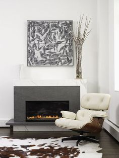 Here's a more modern application using two types of stone: a mix of charcoal gray and white marble. The simple detail of the raised hearth and peek of white marble underneath is very modern and sculptural.