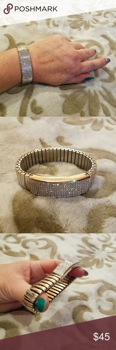 Rebecca Minkoff ~ Silvertone Crystal Bracelet Rebecca Minkoff.  Gently worn & in terrific overall condition.  A beautiful silvertone bracelet that is completely stretch in style for easy on and off.  The centerpiece is a rectangular area that's completely encrusted with clear Austrian crystal Swarovski's.  This is a very special & beautiful piece of jewelry. Rebecca Minkoff  Jewelry Bracelets
