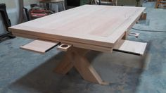 One of the bar's custom gaming tables under construction.