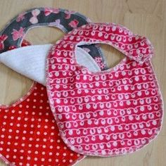 Simple Patterned Bibs - This seems to be the same style as the ones from Buy Buy Baby in your registry.  I am thinking all different patterns in the gray, white, green?