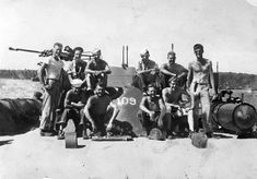 Lieutenant John F. Kennedy (right) and other crew members of PT-109 1943.