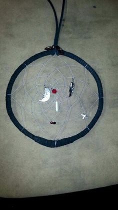 My first time making a dreamcatcher! Not finished tho.