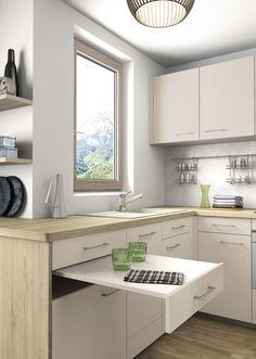 4,7 M² Afin d'agrandir l'espace cuisine et de créer un lien avec le reste de l'appartement, notre concepteur mobalpa a exploité l'ensemble de l'implantation en u et a imaginé un grand plan de travail qui se prolonge vers l'espace de vie. Table escamotable