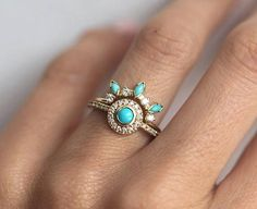 Dreamcatcher turquoise and diamond ring set. ORIGINAL DESIGN from Minimalvs! Custom gemstones are available per request - please contact me before purchase. This set also looks beautiful with moonstones, opals... IF YOU WANT A CUSTOM ring please contact me before purchase. Product details Main ring: - 1x round Turquoise - 4mm - 26x White Diamonds - 1.1mm, color G, VS clarity Curved band: - 4x marquise Turquoises - 4x2mm - 4x White Diamonds - 1.5mm, color G, VS clarity Diamond total cara...