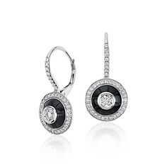 Stunning all over, these one-of-a-kind earrings showcase onyx and round brilliant diamonds framed in 18k white gold.