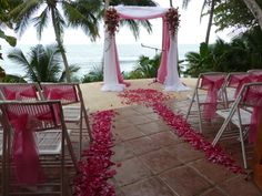 Pink Canopy in front of the beach in Tango Mar.  www.costaricaweddingcelebrations.com