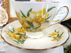COLCLOUGH TEA CUP AND SAUCER YELLOW TEACUP YELLOW DAFFODIL FLORAL