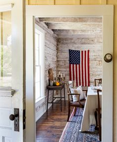 Altogether the inside-and-out renovation project took nearly 10 years! To contrast with the raw wood paneling in most of the cabin, Kurt treated the dining room walls with a soft whitewash.