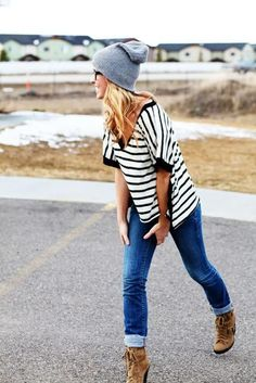 I love the idea of cuffed skinnies, a slouchy tee, heel booties and a beanie. Don't like the sunglasses with it though.