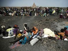 Sudan on the verge of famine - but $6 BILLION has gone missing. A large number of people wait for food air-drops by ICRC (International Committee of the Red Cross), outside Thonyor, in South Sudan, on February 3, 2016.