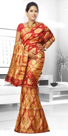 Beautiful Red colour Assam silk pat Mekhla Chadar with artistic Suta work giving a stylish look to the two piece. This gorgeous collection is perfect for any festive occasion.The Mekhla Chadar is a two pc. Saree which comes with matching blouse piece, the blouse shown in the image is just for display purpose.Slight colour variation may be there in display & acutal.