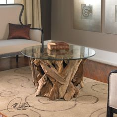 This uniquely natural coffee table features a natural, unfinished teak driftwood base with a clear glass top. Each table is unique and may vary in shape.