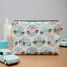 Figaro design available in oilcloth washbags, purses and tote bags. Original design by Susie Faulks.