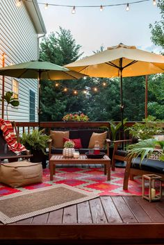 Patio Decor Refresh with Bed Bath & Beyond: Teak Conversation Set The patio set and umbrellas and rugs all highlighted with the string lights as the sun sets Backyard Patio Designs, Diy Patio, Backyard Landscaping, Patio Ideas, Garden Ideas, Deck Oasis Ideas, Backyard Deck Ideas On A Budget, Rustic Patio, Patio Table