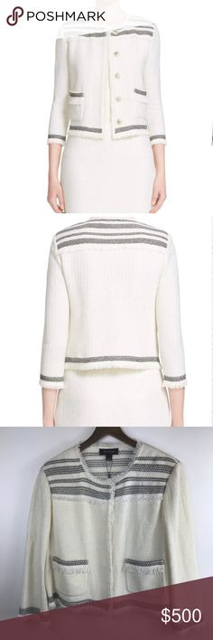 """NWT St. John Berber Knit Jacket in Cream/Caviar Brand new with tags! Retails for $1,595.  Traditional Moroccan textiles and techniques influence this collarless jacket intricately spun with a richly textured basketweave knit and Berber-inspired stripes. Hand-looped fringe trims the edges and patch pockets to further the artisanal aesthetic. 20"""" across  21"""" length; 1"""" fringe  Hidden front-snap closure. Jewel neck. Three-quarter sleeves. Front patch pockets.  25% cotton, 25% rayon, 23% wool…"""