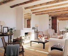salón con chimenea casa de campo