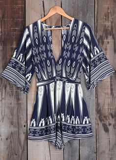 Admire you in this romper? You won't have to ask us twice!! The Plunging neckline and Hollow back are gorgeous displayed in this wonderful abstract print! Plus, the fabric is super soft and comfy!