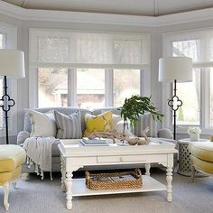 Yellow and Gray Sunroom with Suzanne Kasler Quatrefoil Floor Lamps