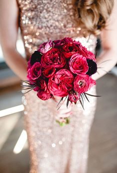 A red bouquet comprised of garden roses, peonies, and anemones with black accents, created by Ali Briskey Designs. Love the brides gold sparkly sequined dress! Photo: Amanda Marie Studio More Beautiful Flowers Like This! Wedding Flower Photos, Red Wedding Flowers, Flower Bouquet Wedding, Floral Wedding, Bridal Flowers, Red Flowers, Red Roses, Beautiful Flowers, Garden Roses Wedding