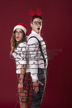 Nerd couple tangle in Christmas lights | |holidays| | Pinterest | Christmas lights, Tangled and Couples