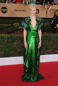"""At the 23rd Annual Screen Actors Guild Awards, Nominee for Female Actor in a Supporting Role for """"Lion"""", Nicole Kidman wore a Gucci emerald sequin gown featuring multicolored feather and beaded parrot embroidered sleeves and skirt with tulle ruffles by Alessandro Michele."""