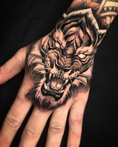 Best Tiger Head Tattoo Designs and Ideas Side Neck Tattoo, Side Hand Tattoos, Neck Tattoo For Guys, Hand Tattoos For Guys, Tiger Hand Tattoo, Skull Hand Tattoo, Tiger Tattoo Design, Skull Tattoos, Lion Hand Tattoo Men