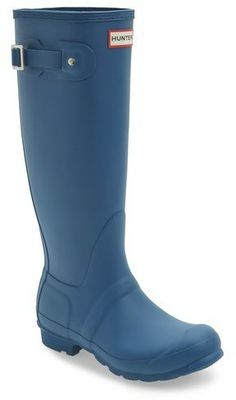 6fa26e5f81b22 A classic finish perfects a puddle-proof rubber boot finished with a  traction-gripping sole. Subtle tonal motifs circle the shaft