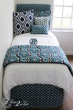 Bright blue and navy dorm room bedding and décor. Designer headboard, custom pillows, exclusive bed scarf, window panels, wall art, bed skirts, twin XL duvet and custom monogramming!! Turn your dorm from drab to fab!!
