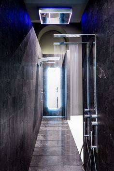 Color + water in action at the Fantini Milano showroom in Milan, Italy.