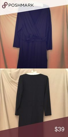 Navy blue Talbot's faux wrap dress size L Great work dress! Long sleeves, 39 1/4 inches from shoulder to hem. 92% nylon, 8% spandex. Machine wash gentle, dry flat. Talbot's Dresses Midi