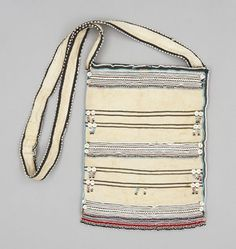 Bag PLACE MADE:Africa: Southern Africa, South Africa, Eastern Cape, Transkei PEOPLE:Gcaleka Xhosa PERIOD:Mid 20th century DATE:1960 - 1970 DIMENSIONS:L 39.5 cm x W 28 cm MATERIALS:Cotton; glass bead; mother of pearl TECHNIQUES:Plain woven; appliquéd; hand-sewn; embroidered; beaded Fabric Patterns, Sewing Patterns, Xhosa, African Art, African Style, African Traditional Dresses, Textiles, African Dresses For Women, Beaded Bags