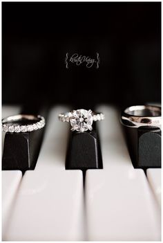 amazing photo of the wedding rings on a piano