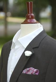How about going simple and old fashioned? Sticking it through the lapel rather than pinning - love this look.
