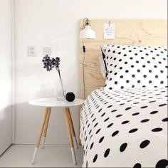 love this calming black, white, and light wood themed bedroom.
