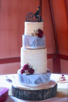 Rustic and Contemporary style Wedding cake with buttercream ruffles and grey and white marbled effect