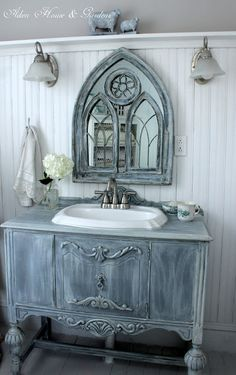 This rustic bathroom vanity adds natural charm to the decor