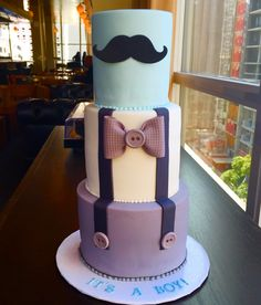 I made this 3 mustache suspenders and bow tie baby shower cake with sugar paste bow  and mustache.