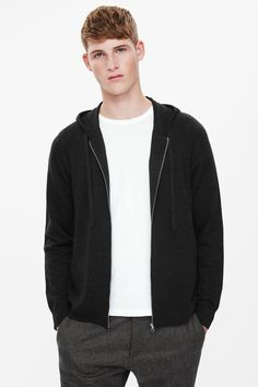 This hooded cardigan is made from wool with a sporty zip-up style and ribbed finishes. A straight fit, it has raglan sleeves, front pockets and neat finishes.