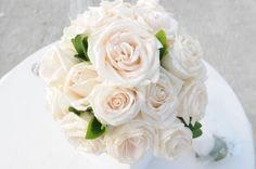 A simple, classic fresh rose bouquet with pearl accents by our Simple Weddings floral designer, Desiree Munera.