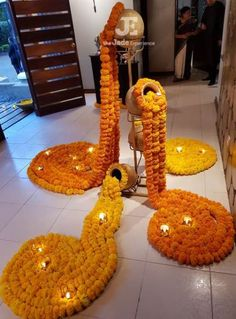 Entrance decor, Done with real marigolds and diyas. Elegant look for an evening function. Done by The Jadee Experience (Nairobi, Kenya.