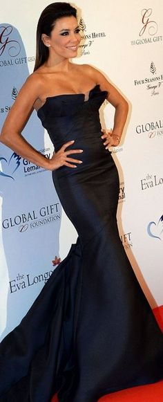 Who made  Eva Longoria's black strapless gown, jewelry, and shoes that she wore in Paris on May 12, 2014?