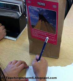 Creating Topic Sentences, passages on front of bag, students read supporting details and write a topic sentence then rotate to another bag.