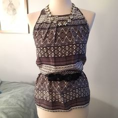 100% silk tribal print tank Cynthia Rowley black and white tribal print blouse tank. High crew neck. Zipper in back. 100% silk. Perfect condition- only wore once !! Belt not included. Cynthia Rowley Tops Blouses