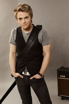 Hunter Hayes, country singer. Half the reason he is attractive is his music. And he has a baby face but in the cutest way