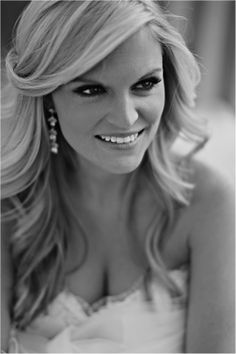 Wedding Hairstyle. Large curls, side part with bangs swept to the side.